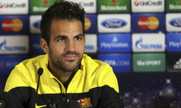 """FILE - A Monday, Sept. 20, 2013 photo from files showing Barcelona's Cesc Fabregas talking to the media during a press conference at Celtic Park, Glasgow, Scotland. Chelsea has announced on its website the signing of Cesc Fabregas from Barcelona on a five-year deal. The 27-year-old Fabregas, who has previously played for Chelsea's London rival Arsenal, says """"I do feel that I have unfinished business in the Premier League"""" and that Chelsea """"match my footballing ambitions with their hunger and desire to win trophies.""""  Fabregas, who is currently with Spain preparing for the World Cup in Brazil, will wear the number four shirt at Chelsea.(AP Photo/Scott Heppell, File)"""