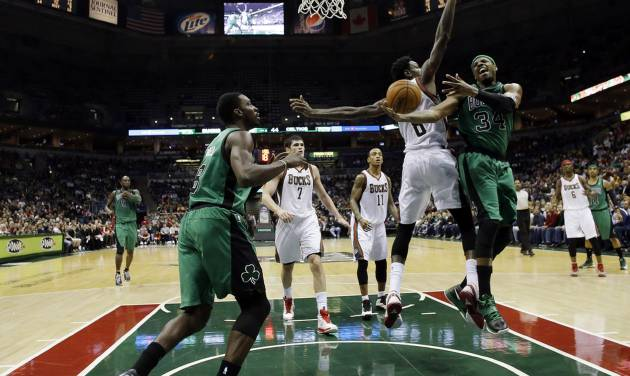 Boston Celtics' Paul Pierce (34) tries to drive to the basket past Milwaukee Bucks' Larry Sanders (8) during the first half of an NBA basketball game on Saturday, Dec. 1, 2012, in Milwaukee. (AP Photo/Morry Gash)