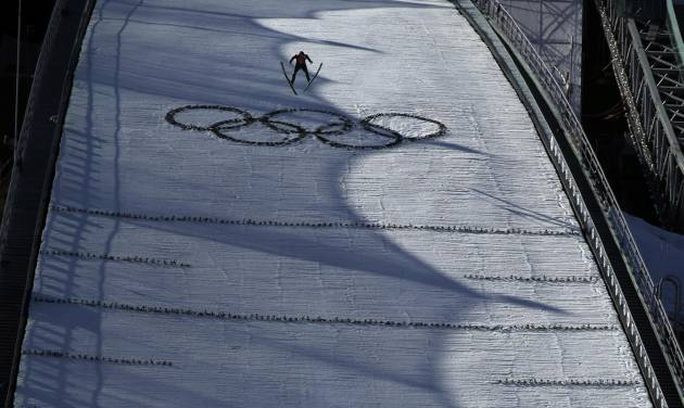Russia's Evgeniy Klimov soars into the air  during the ski jumping large hill portion of the Nordic combined training at the 2014 Winter Olympics, Saturday, Feb. 15, 2014, in Krasnaya Polyana, Russia. (AP Photo/Gregorio Borgia)