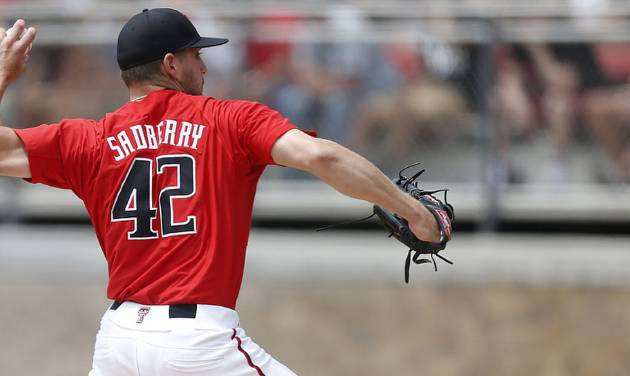 Texas Tech's Chris Sadberry throws a pitch against the College of Charleston during a NCAA college baseball tournament super regional game in Lubbock, Texas, Saturday, June 7, 2014. (AP Photo/Lubbock Avalanche Journal, Shannon Wilson)