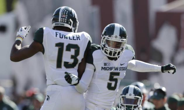 Michigan State wide receiver Bennie Fowler (13) celebrates with cornerback Johnny Adams (5) after Fowler scored on a 36-yard touchdown reception during the second half of an NCAA college football game against Indiana Saturday, Oct. 6, 2012, in Bloomington, Ind. Michigan State defeated Indiana 31-27. (AP Photo/Darron Cummings)