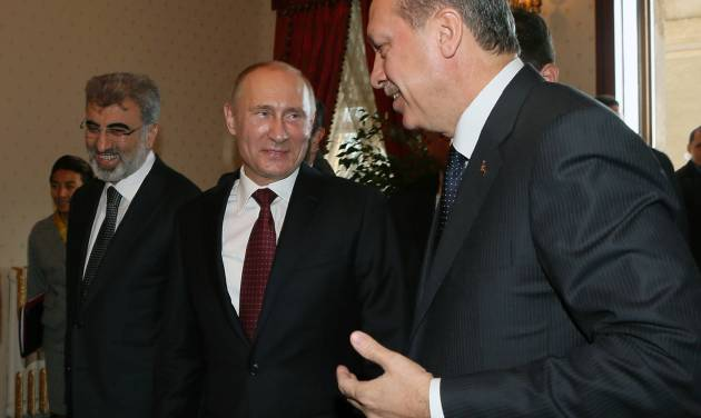 Russian President Vladimir Putin, center, and Turkey's Prime Minister Recep Tayyip Erdogan, right, speake before a meeting in Istanbul, Turkey, Monday, Dec. 3, 2012. Putin visits Turkey on a one-day trip expected to focus on economic issues as well as differing views over how to resolve the Syrian conflict. Turkish Energy Minister Taner Yildiz is at left.(AP Photo/Pool)