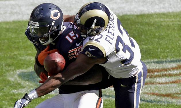 St. Louis Rams cornerback Bradley Fletcher (32) breaks up a pass intended for Chicago Bears wide receiver Brandon Marshall (15) in the second half of an NFL football game in Chicago, Sunday, Sept. 23, 2012. (AP Photo/Kiichiro Sato)