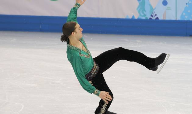 Jason Brown of the United States loses his balance as he competes in the men's free skate figure skating final at the Iceberg Skating Palace during the 2014 Winter Olympics, Friday, Feb. 14, 2014, in Sochi, Russia. (AP Photo/Vadim Ghirda)