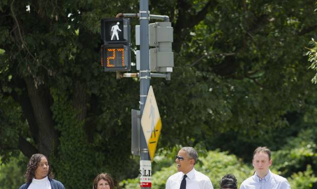 President Barack Obama crosses the street as he walks to have lunch at a Chipotle Mexican Grill in Washington, Monday, June 23, 2014, prior to attending the White House Summit on Working Families. Walking with Obama, from left are, Shirley Young, Lisa Rumain, Shelby Ramirez,  and Rodger Trombley. Obama is encouraging more employers to adopt family-friendly policies, part of a broader effort to convince employers that providing more flexibility is good for business as well as workers. (AP Photo/Pablo Martinez Monsivais)