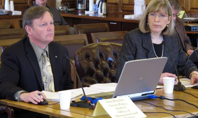 John Boucher and Karen Rehfeld with the Office of Management and Budget appear before the House Resources Committee and House Special Committee on Energy on Wednesday, April 25, 2012, in Juneau, Alaska. Testimony was on the potential impact of the governor's oil tax bill on the state budget. (AP Photo/Becky Bohrer)