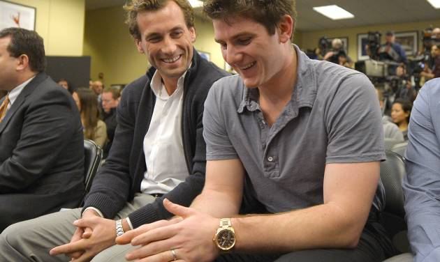 Los Angeles Kings players Jarret Stoll, left, and Jonathan Quick smile during a news conference to help kick off the club's 2012-13 regular season on Thursday, Jan. 10, 2013, in Los Angeles. (AP Photo/Mark J. Terrill)