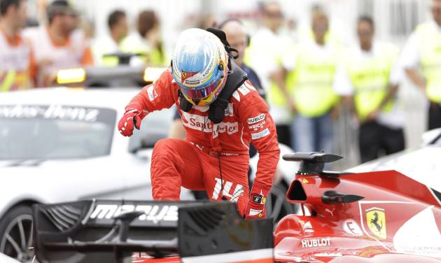 Ferrari driver Fernando Alonso of Spain leaves his car after the Spain Formula One Grand Prix at the Barcelona Catalunya racetrack in Montmelo, near Barcelona, Spain, Sunday, May 11, 2014. He placed sixth. (AP Photo/Luca Bruno)