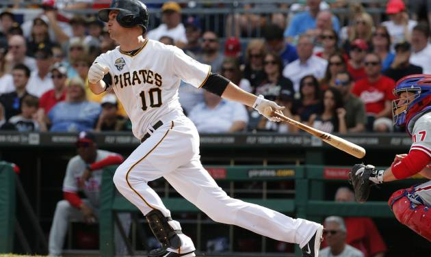 Pittsburgh Pirates' Jordy Mercer (10) drives in two runs with a single off Philadelphia Phillies starting pitcher Roberto Hernandez during the first inning of a baseball game in Pittsburgh, Friday, July 4, 2014. (AP Photo/Gene J. Puskar)
