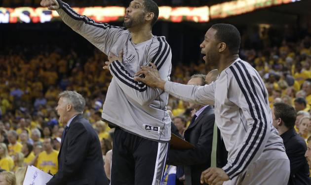 San Antonio Spurs power forward Tim Duncan, left, and shooting guard Tracy McGrady celebrate on the bench during the fourth quarter of Game 6 of a Western Conference semifinal NBA basketball playoff series against the Golden State Warriors in Oakland, Calif., Thursday, May 16, 2013. (AP Photo/Marcio Jose Sanchez)