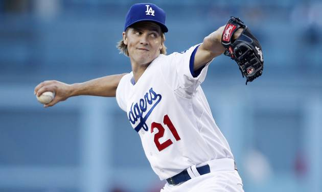 Los Angeles Dodgers starting pitcher Zack Greinke delivers against the Los Angeles Angels during the first inning of a baseball game, Monday, August 4, 2014, in Los Angeles. (AP Photo/Danny Moloshok)