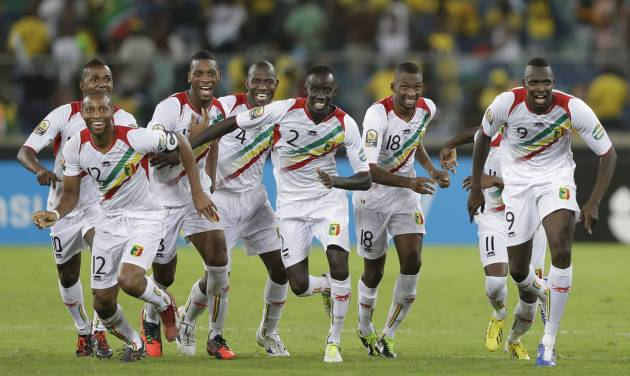 Mali players, including captain Seydou Keita, front left, react as they defeat host nation South Africa on penalties in their African Cup of Nations quarterfinal soccer match, at Moses Mabhida Stadium in Durban, South Africa, Saturday, Feb. 2, 2013. (AP Photo/Rebecca Blackwell)