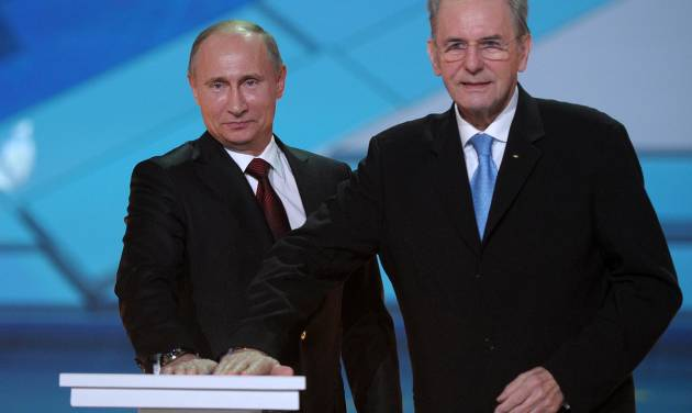 Russian President Vladimir Putin, left, and IOC President Jaques Rogge  press a symbolic button to mark One Year to the start of 2014 Winter Olympics, in Sochi, Russia, Thursday, Feb. 7, 2013.  (AP Photo/RIA-Novosti, Alexei Druzhinin, Presidential Press Service)