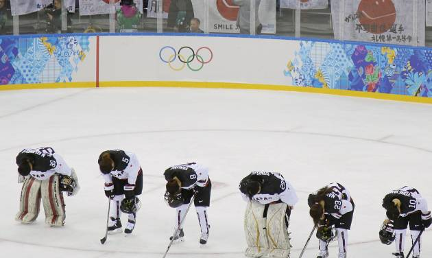 Members of Team Japan bow after their 4-0 loss to Germany in the 2014 Winter Olympics women's ice hockey game at Shayba Arena, Thursday, Feb. 13, 2014, in Sochi, Russia. (AP Photo/Matt Slocum)