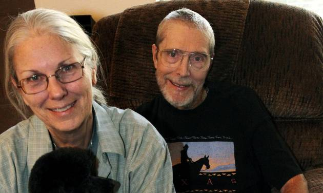 Phil Paschke, right, with his wife Marty and dog Jazz are pictured at their home in Lewisville, Texas, Friday Nov. 2, 2012. Phil is retiring as the coordinator of alcoholism ministry for the Diocese of Dallas. P (AP Photo/The Dallas Morning News, Louis DeLuca) MANDATORY CREDIT; MAGS OUT; TV OUT; INTERNET OUT; AP MEMBERS ONLY