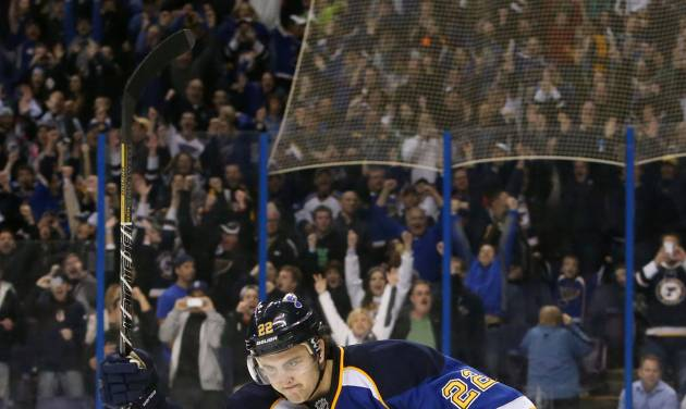 St. Louis Blues defenseman Kevin Shattenkirk raises his stick in celebration after scoring the decisive goal in a shootout during a game between the St. Louis Blues and the Philadelphia Flyers on Tuesday, April 1, 2014, at the Scottrade Center in St. Louis. (AP Photo/St. Louis Post-Dispatch, Chris Lee)