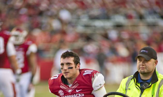 In this file photo taken Nov. 2, 2013, Arkansas quarterback Brandon Allen (10) is driven from the field following an injury during an NCAA college football game against Auburn in Fayetteville, Ark. Much of Arkansas' hopes in 2014 depend on the expected improvement of Allen, who battled injuries for much of last season. (AP Photo/Beth Hall, File)