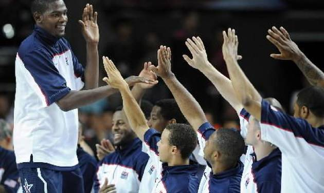 Tournament MVP USA's Kevin Durant, left, celebrates with teammates after the final of the World Basketball Championship between Turkey and the USA, Sunday, Sept. 12, 2010, in Istanbul. USA won 81-64. (AP Photo/Mark J. Terrill)