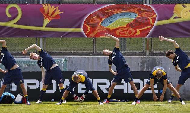 Sweden's players stretch during a training session on the Koncha Zaspa Training Centre near of Kiev, Ukraine, Friday, June 8, 2012.The Sweden team will be based in the capital of Ukraine for the Euro 2012 soccer championships. (AP Photo/Sergei Grits)