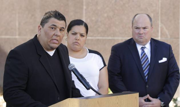 Plaintiff Michael Duran, left, who received nearly $1 million in a sex abuse settlement with the Roman Catholic Archdiocese of Los Angeles, speaks during a news conference on Thursday, March 14, 2013 in Los Angeles. Duran was molested by ex-priest Michael Baker, who is now in jail after pleading guilty to a dozen sex charges. The U.S. church's challenges include recovering from the clergy sexual abuse scandal, which has resulted in the bankruptcies of prominent archdioceses and cost the Church in America an estimated $3 billion in legal settlements. Duran's wife, Margarita, center, and his attorney John Manly look on. (AP Photo/Damian Dovarganes)