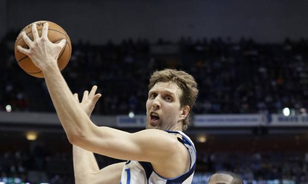 Dallas Mavericks forward Dirk Nowitzki turns against a defending Oklahoma City Thunder forward Kevin Durant (35) during the first half of an NBA basketball game Tuesday, March 25, 2014, in Dallas. (AP Photo/LM Otero)