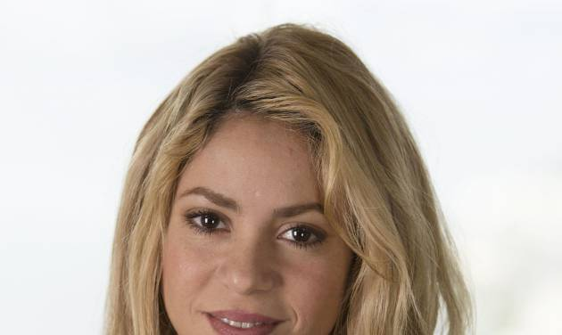 Colombian pop star singer Shakira poses for a photo during an interview in Rio de Janeiro, Brazil, Saturday, July 12, 2014. Shakira will perform at the World Cup's closing ceremony at Maracana Stadium, Sunday. (AP Photo/Leo Correa)