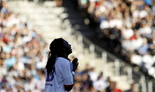 Lyon's Bafe Gomis reacts during their French League One soccer match against Ajaccio at Gerland stadium, in Lyon, central France, Sunday, Sept. 16, 2012. (AP Photo/Laurent Cipriani)