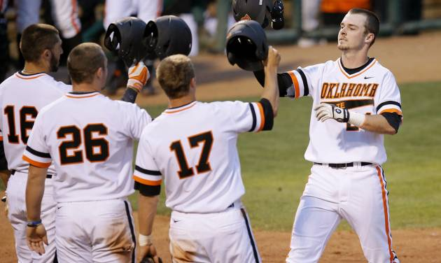 Oklahoma State's Conor Costello celebrates after hitting a four-run home run in the fifth inning of a college baseball game against Oklahoma in Oklahoma City, Thursday, May 15, 2014. (AP Photo/The Oklahoman, Bryan Terry)