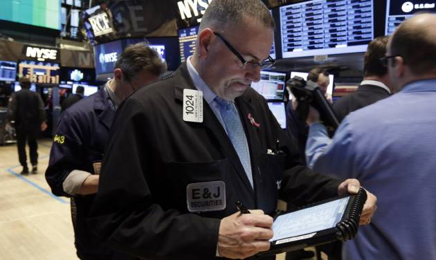 Trader John Yaccarine, center, works on the floor of the New York Stock Exchange Wednesday, March 19, 2014. Stocks are slightly lower in early trading on Wall Street as traders wait for the latest policy decision from the Federal Reserve. (AP Photo/Richard Drew)
