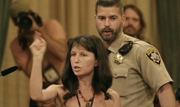 Protester Gypsy Taub speaks out against the Board of Supervisors decision to ban public nakedness while naked at City Hall in San Francisco, Tuesday, Nov. 20, 2012. San Francisco lawmakers on Tuesday narrowly approved a proposal to ban public nakedness, rejecting arguments that the measure would eat away at a reputation for tolerance enjoyed by a city known for flouting convention and flaunting its counter-culture image. The 6-5 Board of Supervisors vote means that exposed genitals will be prohibited in most public places, including streets, sidewalks and public transit. (AP Photo/Jeff Chiu)