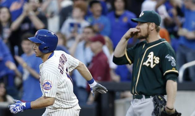 New York Mets' Travis d'Arnaud (15) trots past Oakland Athletics first baseman Brandon Moss (37) after hitting a third-inning three-run home run off Oakland Athletics starting pitcher Scott Kazmir in an interleague baseball game in New York, Tuesday, June 24, 2014. The Mets won 10-1. (AP Photo/Kathy Willens)