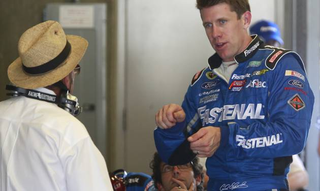 Driver Carl Edwards talks with owner Jack Roush during practice for the Brickyard 400 Sprint Cup series auto race at the Indianapolis Motor Speedway in Indianapolis, Friday, July 25, 2014. (AP Photo/R Brent Smith)