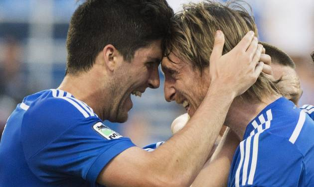 Montreal Impact's Eric Miller, left, and Gorka Larrea celebrate a goal by teammate Jack McInerney against the Houston Dynamo during the first half of an MLS soccer game in Montreal, Sunday, June 29, 2014. (AP Photo/The Canadian Press, Graham Hughes)