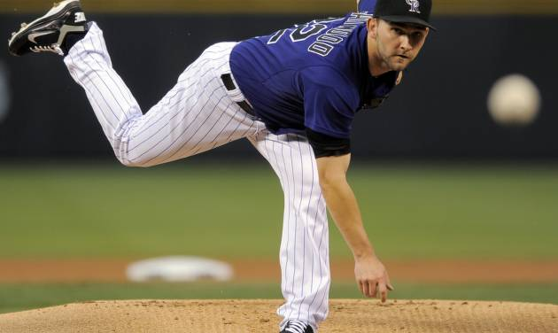 Colorado Rockies pitcher Tyler Chatwood throws against the Arizona Diamondbacks during the first inning of a baseball game, Monday, Sept. 24, 2012, in Denver. (AP Photo/Jack Dempsey)