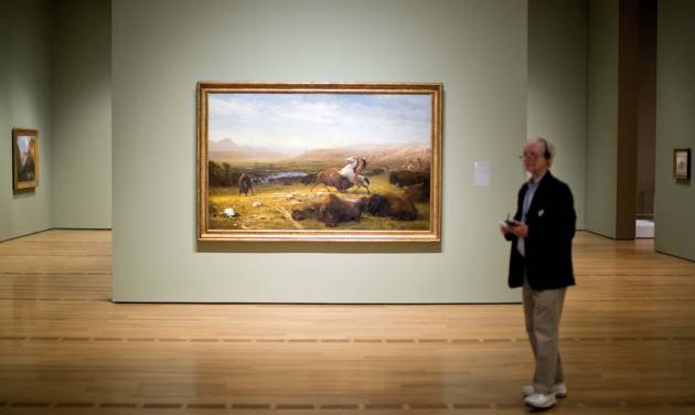 """The painting """"The Last of the Buffalo"""" dating back to 1888 by Albert Bierstadt, is displayed as part of the exhibition, """"Go West! Art of the American Frontier from the Buffalo Bill Center of the West,"""" at the High Museum of Art, Thursday, Oct. 31, 2013, in Atlanta. Atlanta's High Museum of Art is hosting an exhibition of art and historic artifacts that explore the settlement of the American West and the evolving views of the land and people the earliest arrivals encountered. It includes more than 250 paintings, sculptures, photos, firearms and Native American artifacts. The works of art included in the exhibition cover a 100-year period from 1830 to 1930. (AP Photo/David Goldman)"""