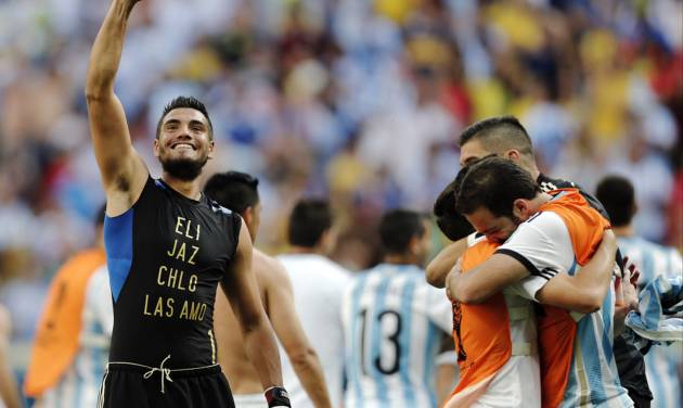 CORRECTS PHOTOGRAPHER'S BYLINE - Argentina goalkeeper Sergio Romero, left, and teammates celebrate at the end of the World Cup quarterfinal soccer match between Argentina and Belgium at the Estadio Nacional in Brasilia, Brazil, Saturday, July 5, 2014. Argentina won 1-0. (AP Photo/Eraldo Peres)