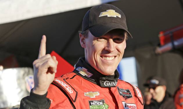 Alex Gurney holds up a finger signify that he won the pole, after qualifying for the IMSA Rolex 24 hour auto race at Daytona International Speedway in Daytona Beach, Fla., Thursday, Jan. 23, 2014.(AP Photo/John Raoux)
