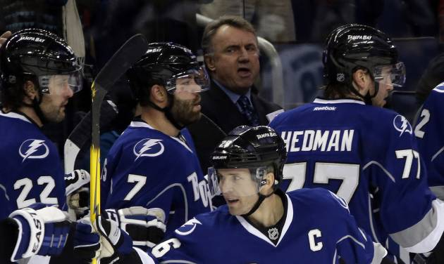 Tampa Bay Lightning right wing Martin St. Louis (26) celebrates after scoring his third goal against the San Jose Sharks during the first period of an NHL hockey game Saturday, Jan. 18, 2014, in Tampa, Fla. St. Louis had a hat trick in the period. (AP Photo/Chris O'Meara)