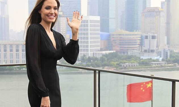 "Actress Angelina Jolie waves during a promotion tour for her movie ""Maleficent"" in Shanghai, China Tuesday, June 3, 2014. (AP Photo)"