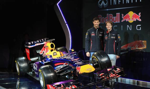In this photo dated Sunday Feb. 3, 2013 and provided by Red Bull Racing, Red Bull racing drivers Mark Webber, left, and Sebastian Vettel stand alongside the new car during the Infiniti Red Bull Racing RB9 launch in Milton Keynes, England. (AP Photo/Richard Heathcote, HO)