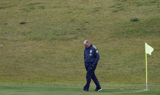Brazil's coach Luiz Felipe Scolari walks on the pitch during practice at the Granja Comary training center in Teresopolis, Brazil, Friday, July 11, 2014. Brazil will face the Netherlands in the World Cup third-place match Saturday. (AP Photo/Leo Correa)