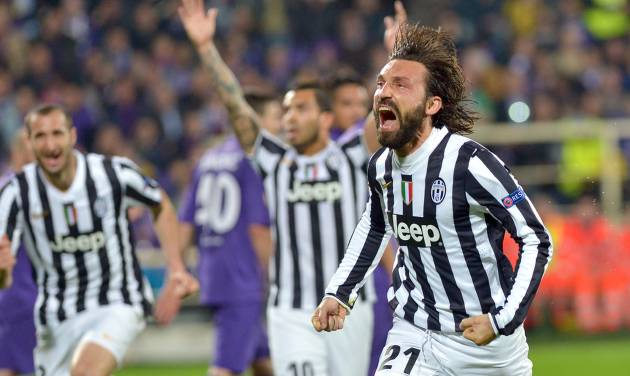 Juventus' Andrea Pirlo celebrates after scoring during an Europa League, round of 16, return-leg soccer match between Fiorentina and Juventus, at the Artemio Franchi stadium in Florence, Italy, Thursday, March 20,, 2014. (AP Photo/Massimo Pinca)