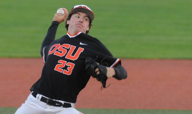 Oregon State starter Andrew Moore delivers a pitch against North Dakota State during an NCAA college baseball tournament regional game in Corvallis, Ore., Friday, May 30, 2014. (AP Photo/Mark Ylen)