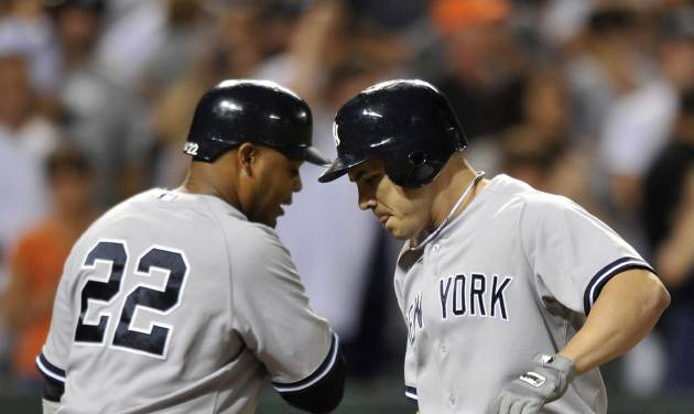 New York Yankees' Steve Pearce, right, celebrates his two-run home run against the Baltimore Orioles with Andruw Jones, who scored on the play, in the fourth inning of a baseball game Friday, Sept. 7, 2012, in Baltimore. (AP Photo/Gail Burton)