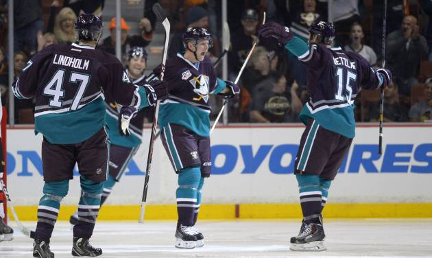 Anaheim Ducks right wing Corey Perry, center, celebrates his goal with center Ryan Getzlaf, right, as defenseman Hampus Lindholm, of Sweden, looks on during the first period of their NHL hockey game, Sunday, Oct. 13, 2013, in Anaheim, Calif. (AP Photo/Mark J. Terrill)