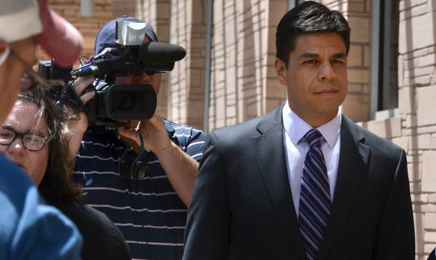 Jamie Estrada, 41, of Los Lunas, N.M., leaves Federal Court in Albuquerque, N.M., Monday June 16, 2014,  after pleading guilty to the unlawful interception of electronic communications and false statements charges arising out of the unlawful interception of emails intended for others, including New Mexico Governor Susana Martinez and members of her staff.   (AP Photo/The Albuquerque Journal, Greg Sorber)