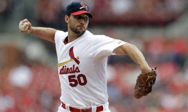 St. Louis Cardinals starting pitcher Adam Wainwright throws during the first inning of a baseball game against the Pittsburgh Pirates, Sunday, April 27, 2014, in St. Louis. (AP Photo/Jeff Roberson)