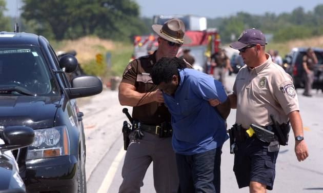 Attempted bank robbery suspect in custody following fatal high-speed chase north of Quapaw, Okla. on 69a Hwy.  The suspect was found by OHP airplane hiding in some weeds not far from the crash scene.   Gary Crow/For the Oklahoman