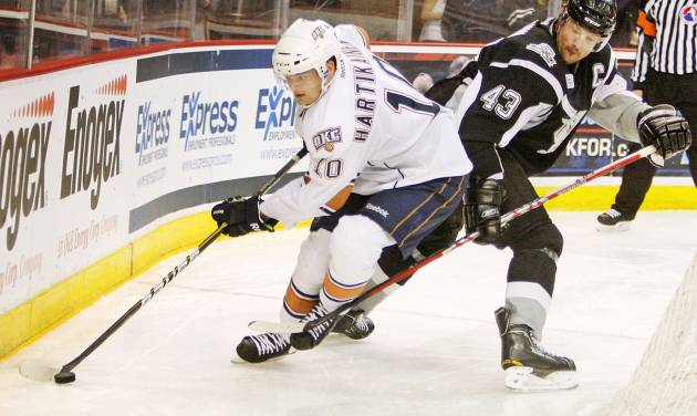 Oklahoma City's Teemu Hartikainen (10) skates away from San Antonio's Nolan Yonkman (43) in the second period during the AHL hockey game between the Oklahoma City Barons and the San Antonio Rampage at the Cox Convention Center in Oklahoma City, Thursday, Feb. 2, 2012. Photo by Nate Billings, The Oklahoman