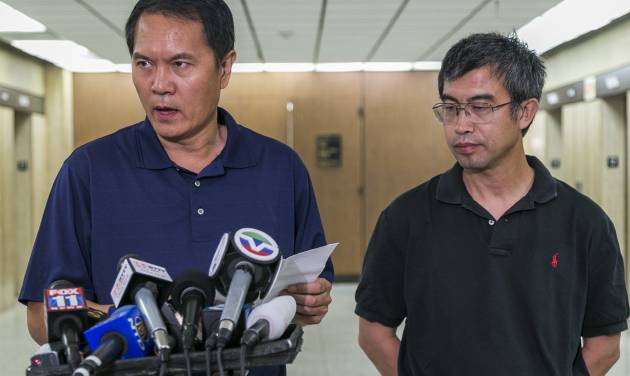 George He, left, and Sean Kong, right, both friends of the father of slain Chinese student Xinran Ji, read a statement from the family on behalf of his parents, as they are still in China unable to get a U.S. travel visa, at Los Angeles Superior Court on Tuesday, July 29, 2014. Four teens are charged with murder in the fatal beating of a University of Southern California graduate student with a baseball bat and wrench as he walked to his off-campus apartment after meeting with a study group. (AP Photo/Damian Dovarganes)